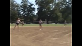 Coach shows two female athletes how to properly handle a big bat
