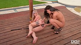 Dominatrix Coco De Mal Penetrates Helena Valentine with a Black Double Dong