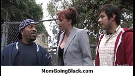 Milf opens her legs for a black cock 12