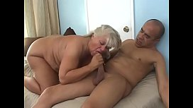 Blonde fatty lies on bed and let her man brush her bush