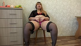 A fat girl in stockings trying on different panties and masturbating her ass and