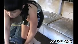 Busty domina ties a stud and makes him do foot and ass worship