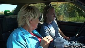 Hitchhiking blonde granny picked up and doggy-fucked roadside