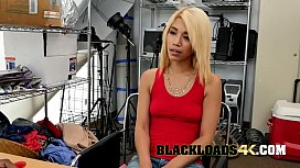 Petite blonde babe is getting fucked from behind by a huge black cock.