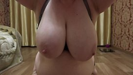 Mature milf with big tits and with big ass demonstrates a plump figure and masturbates hairy pussy. Close-up.