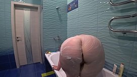 Lesbian washed and fucked a mature bbw in the bathroom. Milf shakes a big soapy booty doggystyle.