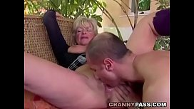 Busty Granny Takes Young...
