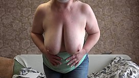 Mom in front of the webcam seduces a stranger and masturbates with him. Mature bbw undressing, shaking big tits, fat booty, fingering hairy pussy.