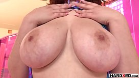 Chubby redhead babe with gigantic tits shows her skills