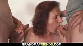 Two young dudes fuck nude old woman