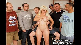 Big tittied blonde milf Clarissa finds cock at Dirty D'_s bukkake party