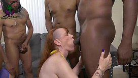 Ebony and redhead fuck a group of guys