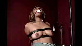 Older slut gets titillated while being strapped tight
