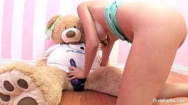 Brett Rossi plays with...