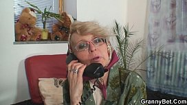 Lonely granny pleases a...