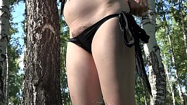 A walk through the woods with a dildo in a hairy pussy. Milf in early pregnancy masturbates outdoors.