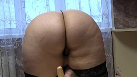 Beautiful BBW in stockings jumps on a dildo and shakes fat booty.