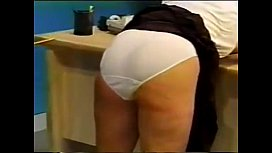 Schoolgirl gets a caning...