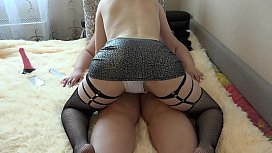 Mature lesbians have fun on the couch. A dildo in a hairy pussy, a juicy ass in panties, and natural tits with big nipples look sexy. Homemade fetish.