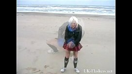 Squirting beach babe in...