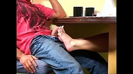 Footjob under table and...