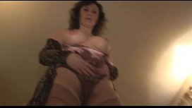 Mature lady in slip and stockings with perfect boobs strips