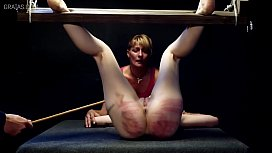 Merciless caning for blonde...
