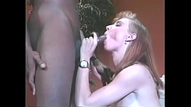 Watch white brunette Mona Lisa get on her knees to suck a big black cock