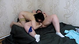 Chubby lesbians lick each other'_s pussy. Facesitting, cunnilingus, and oral sex of two girlfriends at home on the bed. Fetish.