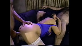 Mature milf with a big ass Ginni Lewis fucks with several guys on the couch and gets an ocean of cum on her big tits