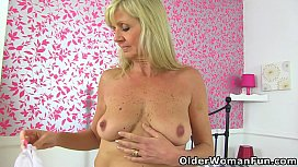 English gilf Dolly toys her pussy and fingers her arse