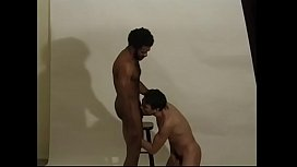 Horny black cameraman Andre Bolla with hairy chest proposes white handsome joy boy Dereck Bishop to clean his huge pipe in the studio