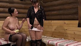 Two mature fat lesbians have fun with a wide zucchini, pussy licking and stretching a wet hole.