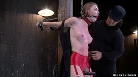 Sub bound in strappado gets whipped