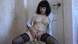 A brunette in stockings masturbates with a big dildo and then sucks this sex toy in orgasm juices from a wet pussy.