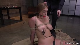 Busty slave made to...