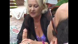 Well-padded mature blonde lady Anastasia Sands makes clear if handsome fellow having rest in chaise-longue is able to spare a while to help her bail out of the difficulties