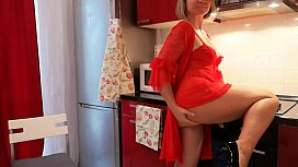 Horny mature fucks herself in the kitchen.