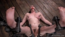 Busty hairy slave tormented in device