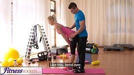 FitnessRooms Bendy Blonde Bends Over for her Personal Trainer