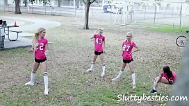 Entire girls football team plays with balls