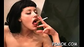 Hawt babe touches herself whilst relishing a cigarette
