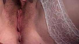 Mature hairy pussy closeup outdoors. Milf in white stockings masturbates in the clearing to orgasm.