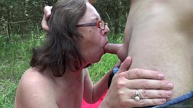 Slutty granny relaxing outside and banging with a y. stranger
