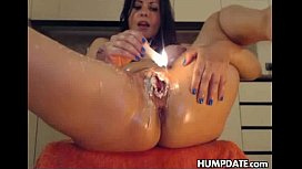 Kinky babe applies hot candle wax on her shaved gape pussy