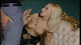 Blonde slut in black stockings wants to fuck on a couch