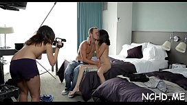 Lovely looking nubile gets team-fucked in front of a camera
