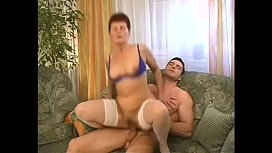 Nasty mature woman with red hair Sari is fond of getting her twat stretched with young hard dong