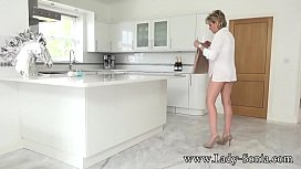 Lady Sonia masturbating on the kitchen counter