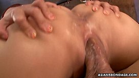 Bound Asian hottie receives...